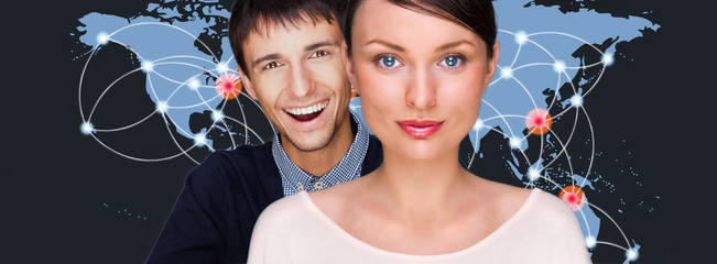 Handsome friendly couple in futuristic interface standing in fro