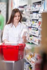 Female Holding Medicine Box