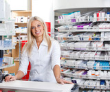 Female Pharmacist Standing at Checkout Counter