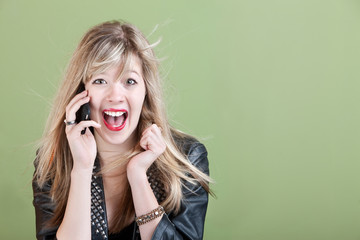 Excited Young Woman on Phone