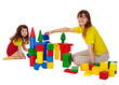 Happy mother and daughter playing with blocks