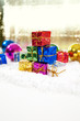 christmas gifts with baubles and snow