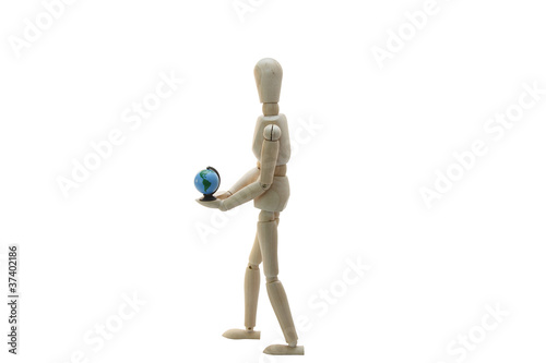 A Wooden Manikin Holding A World Globe