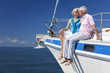 Happy Senior Couple Sitting on a Sail Boat - 37402338
