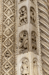 Carving on the Facade of the cathedral in Ferrara Italy