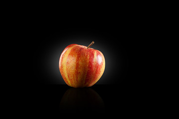 Etna red apple on a black background
