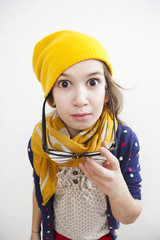 Silly little girl ten years old in yellow knitting  hat