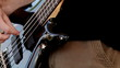 man playing black bass guitar, fast zoom in