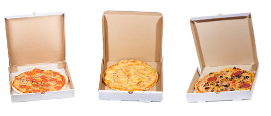 set with different pizza in open paper box
