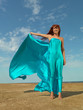 happy woman desert beach wind blowing dress