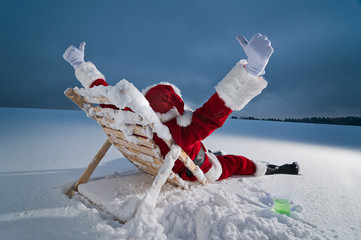 Santa relaxing on a sunbed