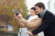 Touristen fotografieren mit Smartphone