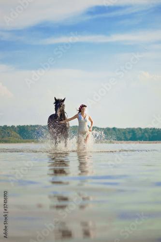 Woman on a horse by the sea © Miramiska