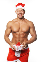 Image of sexy man wearing santa claus costume