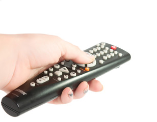 Black TV remote control in hand