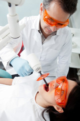 Dentist using laser