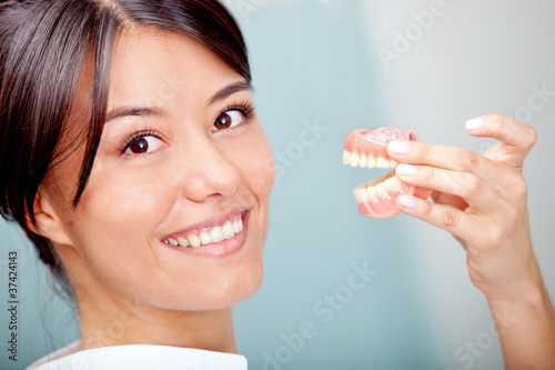 Woman holding teeth sample