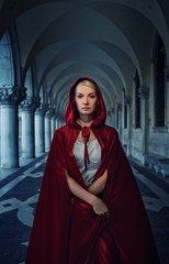 Beautiful woman in red cloak outdoor