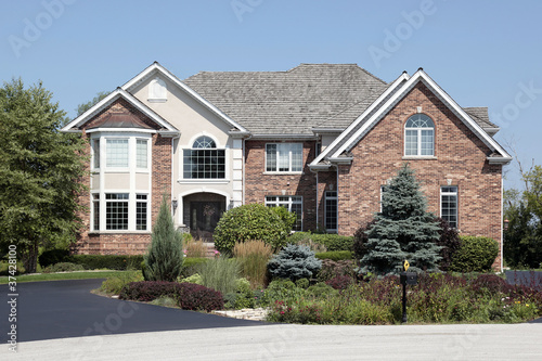 Brick home with front landscaping