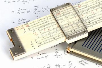 Slide rule close up with work sheet