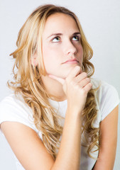 studio portrait of a beautiful blonde girl with expressions