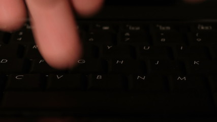 HD - Man's hands typing on a computer keyboard