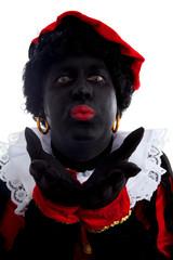 Portrait of kissing Zwarte piet ( black pete)
