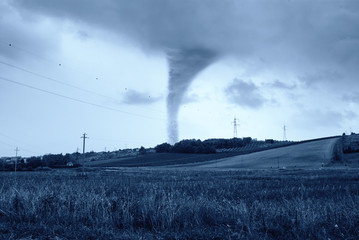 incredible twister behind the hill