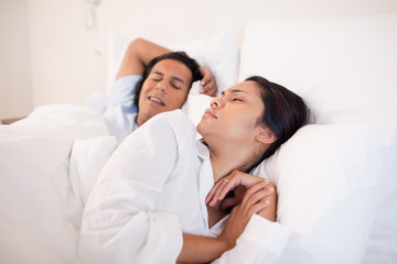 Woman being woken up by snoring boyfriend