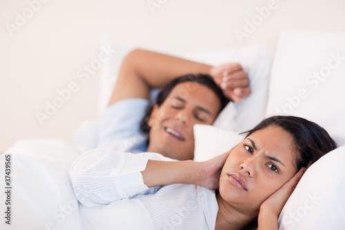Man waking his girlfriend with snoring