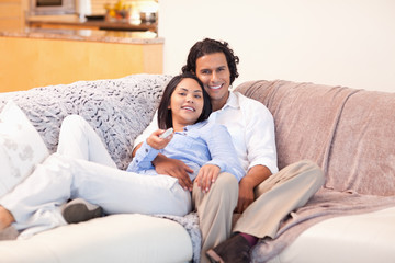 Couple enjoys watching television together