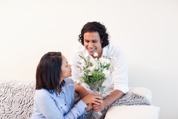 Man giving his girlfriend flowers