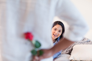 Female about to get a rose by her boyfriend