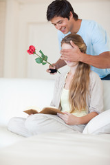 Portrait of a man offering a rose to his girlfriend