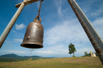 bell on mountain and blue sky