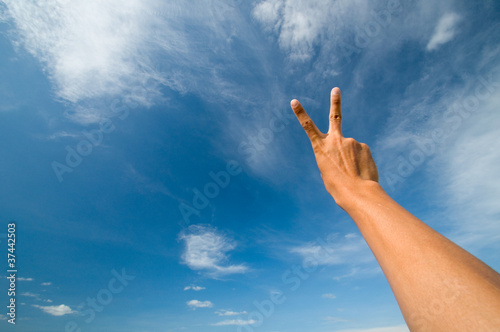 sign of hand and blue sky