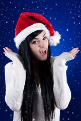 Beautiful girl with Santa hat