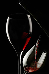 red wine glass isolated on black background