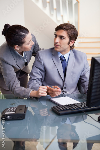Businesswoman explaining something to her colleague