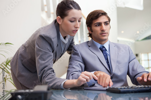 Business team working on pc together
