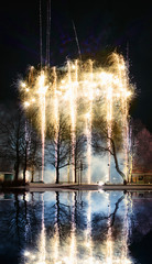 Fireworks over water in park