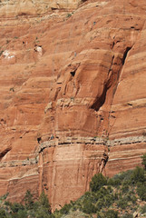 A Team of Climbers Ascend a Sandstone Cliff