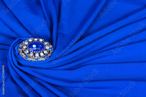 Brooch on blue