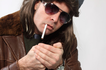 Man with mullet and cigarette.