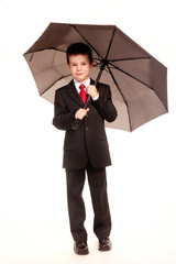 Boy in official dresscode with an umbrella