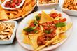 Nachos, corn chips with chili sauce