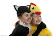 Two girls play in fancy dress of a chicken and cat. Isolated whi