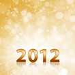 Year 2012 with abstract gold sparkling background