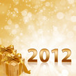 Year 2012 with abstract gold sparkling background ang gold gift