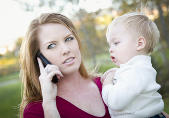Attractive Woman Using Cell Phone with Child